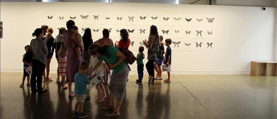 Women and children view an art piece at the Franklin Art Centre.