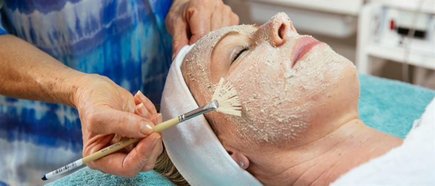 Woman recieves exfoliation treatment