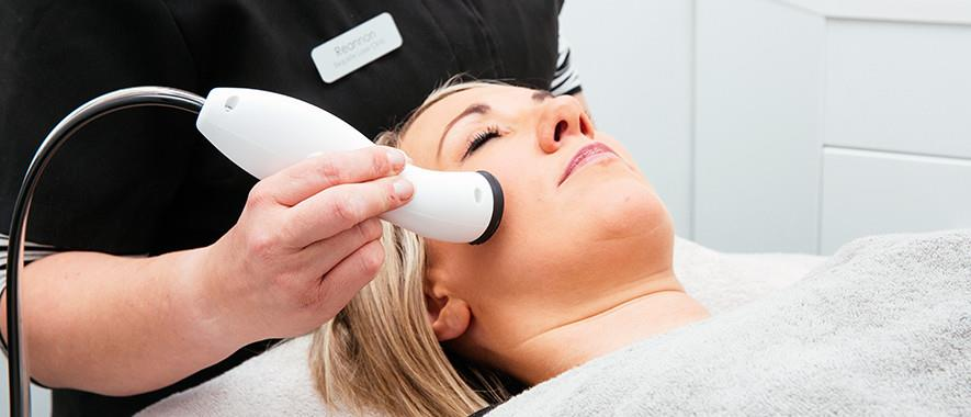 Patient undergoes treatment in a pulsed light and laser treatment business.