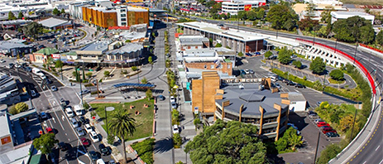 Aerial photo showing New Lynn's transport hub, retail areas and apartments.