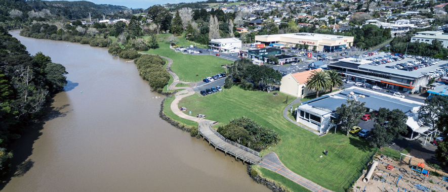 Photograph of Warkworth from the Mahurangi river overlooking the Warkworth library and shopping area