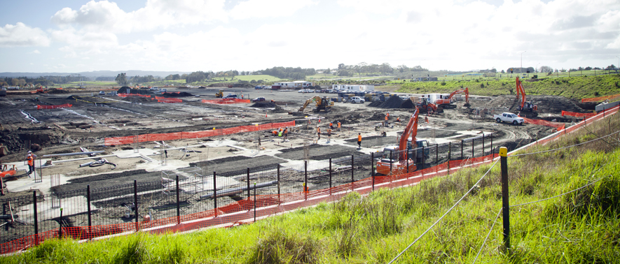 Photograph of construction underway at a future commercial area
