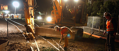 Photo of work being done on railway lines at night.