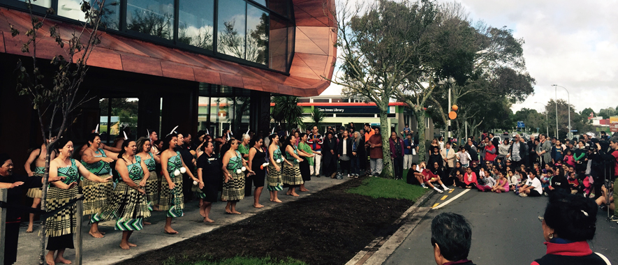 Photograph of a culture group performing at Te Oro the Glenn Innes music and arts centre, which showcases Māori design elements in the building.