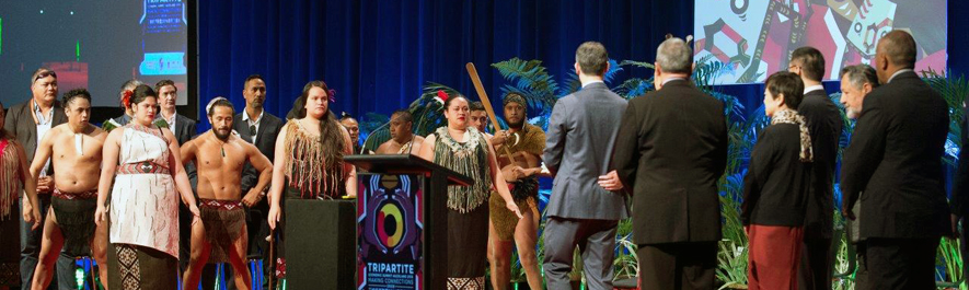 Photograph from Tripartite Economic Alliance showing a traditional Māori group welcoming international delegates.