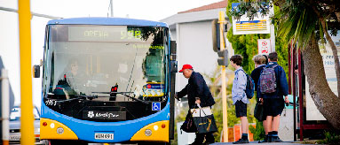 Passengers boarding a bus.
