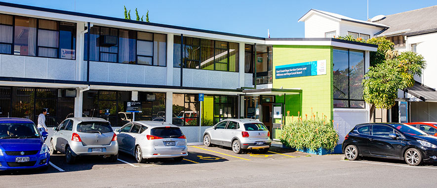 The front entrance to Hibiscus Bays Service Centre and adjoining customer parking.