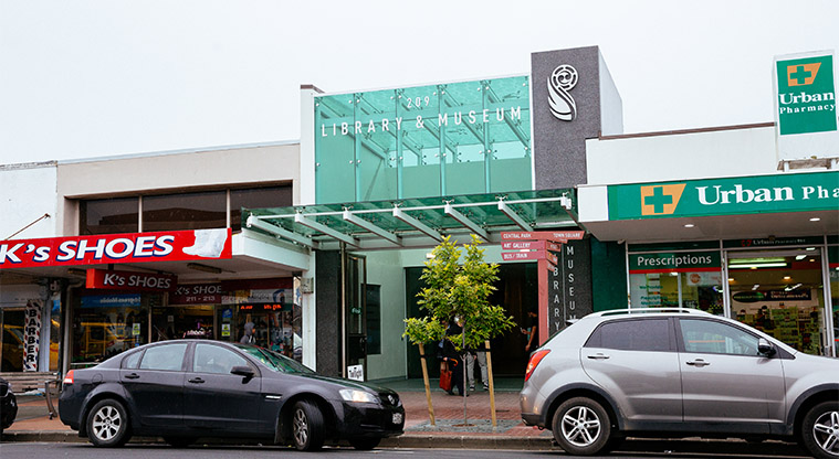 The front entrance and steps to Papakura Service Centre with customer parking outside the building.